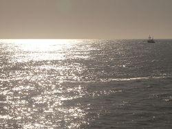 soleil et pêche, mer du Nord